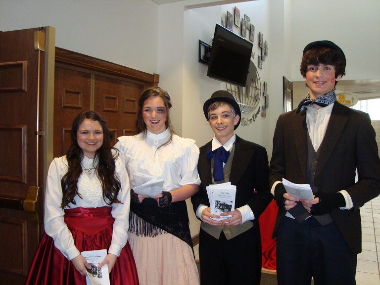 Middle School students in Dickens costumes